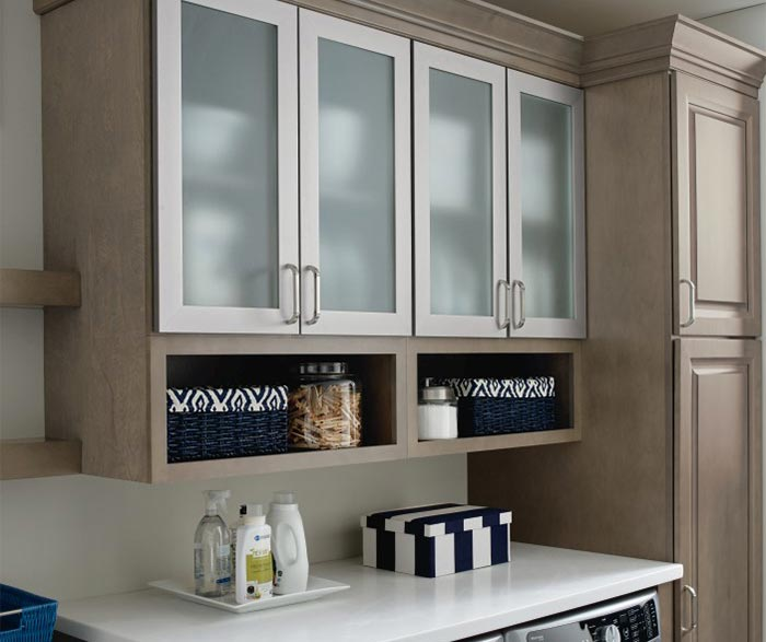 Close up of aluminum frame cabinet doors in laundry room