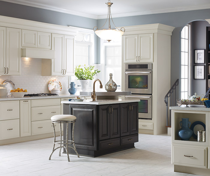 Sullivan off white kitchen cabinets in Coconut with a dark grey kitchen island in Storm