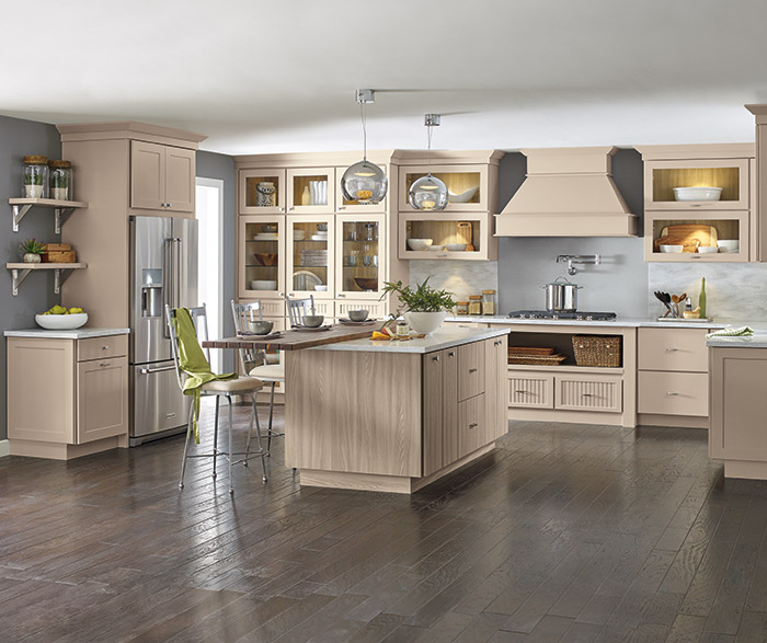 Transitional kitchen with beige cabinets and a woodgrain laminate island