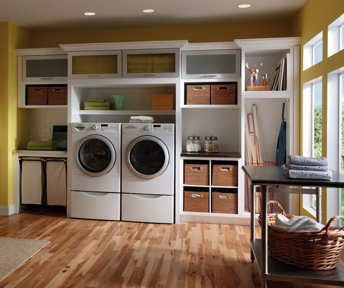 Laundry room cabinets in painted white maple by Diamond Cabinetry