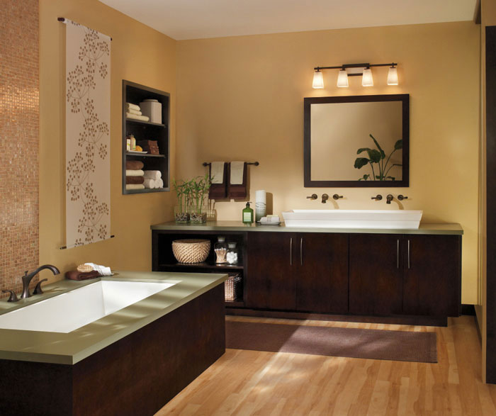 Contemporary bathroom design in dark cherry finish by Diamond Cabinetry