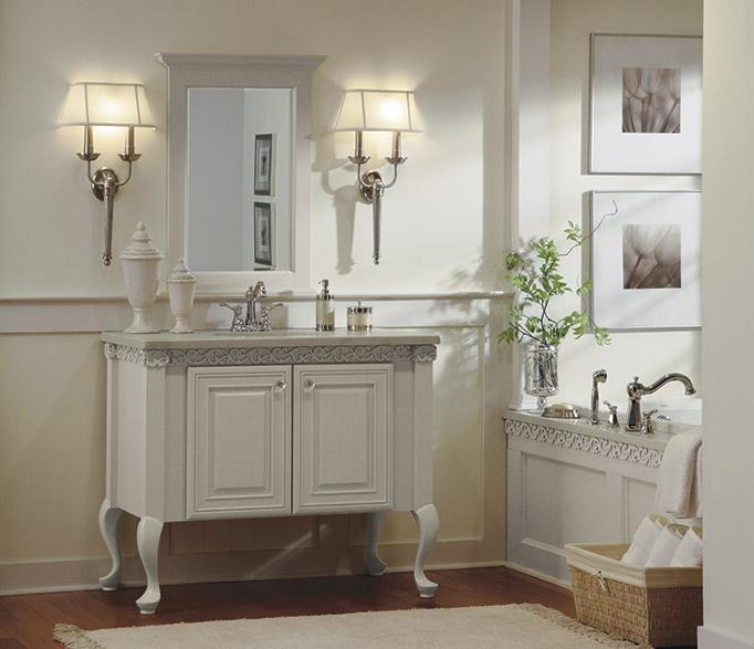 Light gray bathroom vanity and tub surround