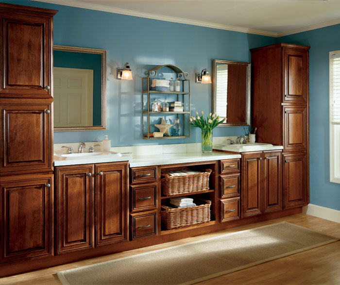 Traditional cherry bathroom cabinets by Diamond Cabinetry