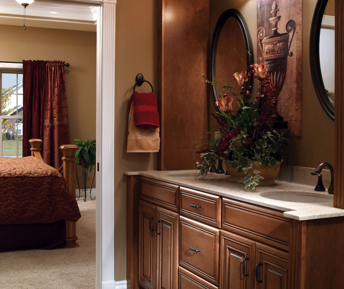 Traditional maple bathroom cabinets by Diamond Cabinetry